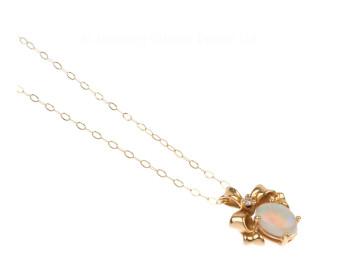 14ct Yellow Gold 0.65ct Opal & Diamond Bow Pendant